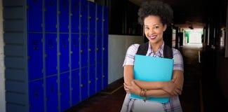 Image composée de jeune femme occasionnelle avec le dossier dans le bureau photographie stock libre de droits