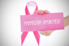 Image composée de jeune femme tenant la carte rose Photographie stock libre de droits