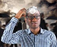 Image composée de jeune homme d'affaires pensant rayant la tête Image stock