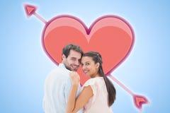 Image composée de jeunes couples attrayants souriant à l'appareil-photo Photo stock