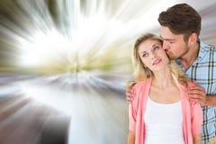 Image composée de jeunes couples attrayants souriant ensemble Image libre de droits