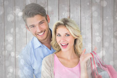 Image composée de jeunes couples attrayants tenant des paniers Photographie stock