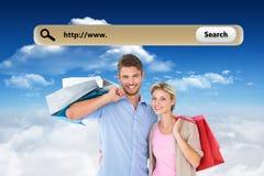 Image composée de jeunes couples attrayants tenant des paniers Photo stock