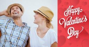 Image composée de jeunes couples de hanche riant sur le banc Photos libres de droits