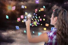Image composée de jolie brune dirigeant quelque chose avec son doigt 3d Images stock