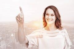 Image composée de jolie femme se dirigeant avec son doigt photos libres de droits