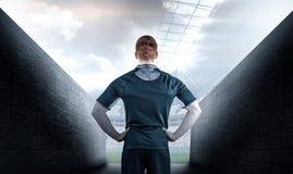 Image composée de joueur de rugby avec des mains sur des hanches Photos stock