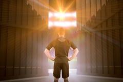Image composée de joueur de rugby avec des mains sur les hanches 3d Photos libres de droits