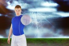 Image composée de joueur de rugby remettant une boule de rugby 3D Images libres de droits