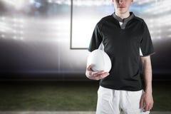 Image composée de joueur de rugby tenant une boule de rugby image stock