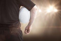 Image composée de joueur de rugby tenant une boule de rugby Photographie stock libre de droits