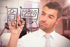 Image composée de l'écriture concentrée d'homme d'affaires avec le marqueur Photographie stock
