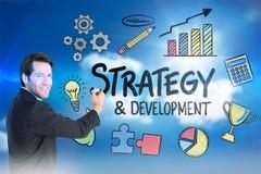 Image composée de l'écriture d'homme d'affaires avec le marqueur tout en regardant l'appareil-photo Image stock