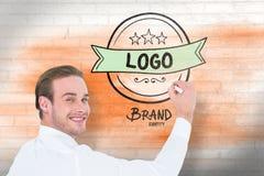 Image composée de l'écriture gaie d'homme d'affaires avec le marqueur Images stock