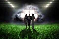 Image composée de l'équipe de femmes d'affaires regardant l'appareil-photo Photo stock