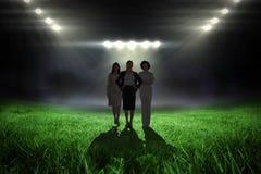 Image composée de l'équipe de femmes d'affaires regardant l'appareil-photo Photographie stock