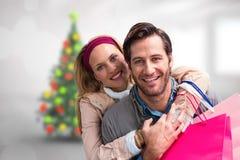 Image composée de l'embrassement de sourire de couples Photographie stock