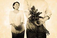 Image composée de l'homme se tenant avec des roses à côté de la femme Photo libre de droits
