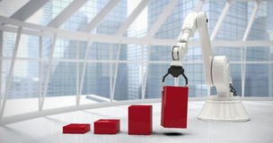 Image composée de l'image composée du robot arrangeant les blocs rouges de jouet dans le ghaph 3d de barre Image libre de droits