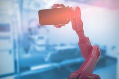 Image composée de l'image composée du robot montrant le téléphone portable 3d Photos libres de droits