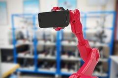 Image composée de l'image composée du robot montrant le téléphone portable 3d Image libre de droits