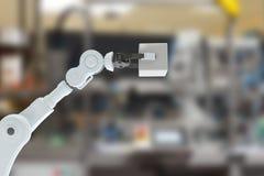 Image composée de l'image cultivée de la main robotique tenant le cube 3d Photos libres de droits