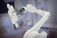 Image composée de l'image du robot tenant le puzzle 3d de jeu Photos stock