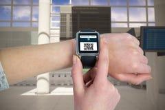 Image composée de la femme employant le smartwatch Photos stock