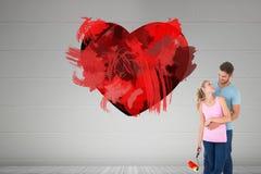 Image composée de la jeune peinture de couples avec le rouleau Image libre de droits