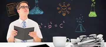 Image composée de la lecture geeky d'homme d'affaires du livre photos stock