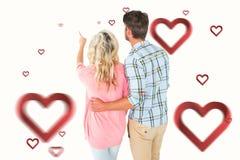 Image composée de la position et du regard attrayants de couples Image libre de droits
