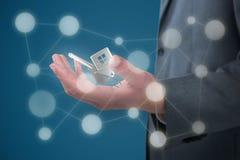 Image composée de la section médiane de l'homme d'affaires tenant l'objet invisible sur le fond blanc 3D Photos libres de droits