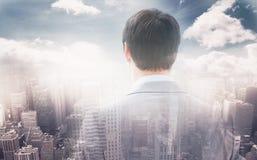 Image composée de la vue arrière de l'homme d'affaires regardant par la fenêtre de construire 3d Photos stock