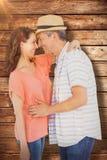 Image composée de la vue de côté des couples regardant l'un l'autre Photo stock