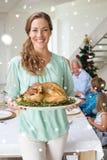 Image composée de mère heureuse avec le repas de Noël Photo stock