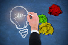 Image composée de main de l'écriture d'homme d'affaires avec une craie blanche Photos libres de droits