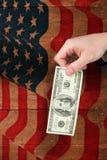 Image composée de main tenant cent billets d'un dollar Photo stock