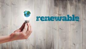 Image composée de main tenant l'ampoule environnementale Image stock