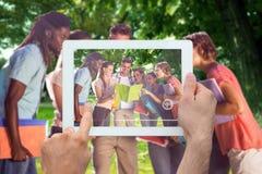 Image composée de main tenant le PC de comprimé Photographie stock libre de droits