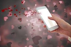 Image composée de main utilisant le téléphone portable Images stock