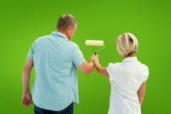 Image composée de mur blanc de peinture de couples plus anciens heureux Photo stock