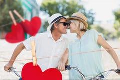 Image composée de nez heureux de frottage de couples Image stock