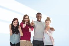 Image composée de portrait d'équipe de sourire d'affaires avec des pouces  Images libres de droits