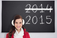 Image composée de portrait d'une brune de sourire avec l'usage d'hiver Images libres de droits