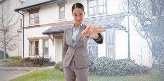 Image composée de portrait d'une femme d'affaires de sourire tenant une clé image stock