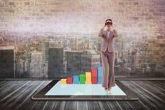 Image composée de portrait d'une femme d'affaires regardant par des jumelles Photographie stock libre de droits