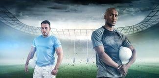 Image composée de portrait de sportif sûr avec la boule de rugby Photo stock
