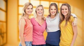 Image composée de quatre amis se tenant près de l'un l'autre et du sourire Photographie stock