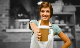 Image composée de serveuse dirigeant loin une tasse de café images libres de droits