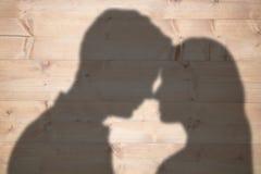 Image composée de tête debout de couples contre la tête Image stock
